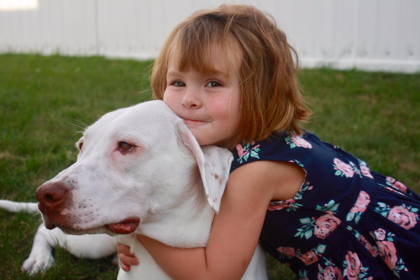 blonde girl with white dog