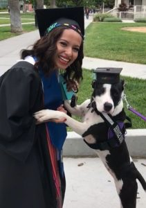 woman graduating with service dog