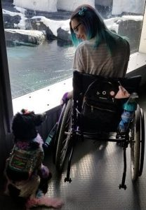 woman on wheelchair with service dog