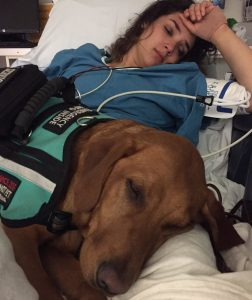 sick woman with service dog