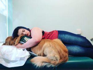 woman hugging service dog